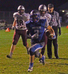 Eddie Caviedes rushes for a Montague touchdown in its opening playoff win over Delton Kellogg. Photo/Scott Stone