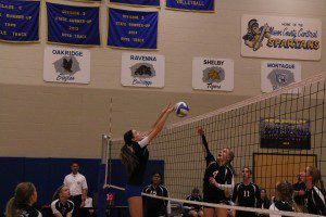 Hart's Jessica Riggs attempts the spike against Ravenna's Amber Jacobs. Photo/Steve Markel