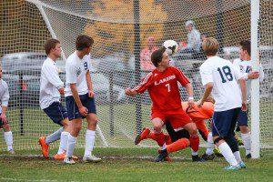 Spring Lake's Ryan Zietlow heads the winning goal into the net. Photo/Kevin Sielaff