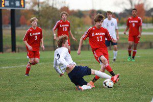 Zach Shane makes the slide tackle on Spring Lake's Dylan Constantine. Photo/Kevin Sielaff