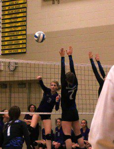 McKenna Peters on the spike for Shelby as Oakridge's No. 7 Jade Ware looks for the block. Photo/Steve Markel