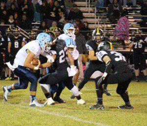 Mona Shores quarterback Tyler Trovinger on the rush. Photo/Jason Goorman