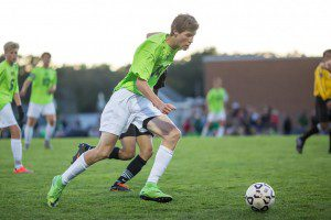 WMC's Clay Negen fights for position as he controls the ball up field. Photo/Randy Riksen
