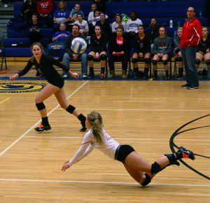 Hanna Evans finds the dig for Whitehall with No. 8 Alyssa Myers preparing for the set. Photo/Steve Markel