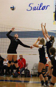 Whitehall's No. 14 Brianna Copley goes for the spike. Photo/Jason Goorman