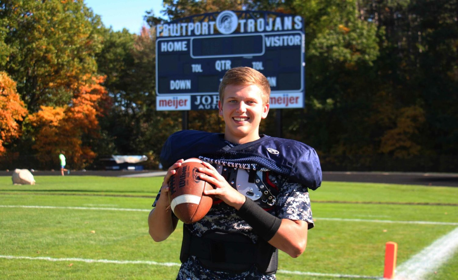 Fruitport quarterback Jarod Wierengo is using his dual-threat skills to help secure a playoff spot for the Trojans