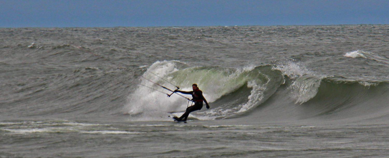 Lake Michigan waves kick up activity at Pere Marquette Beach [VIDEO]