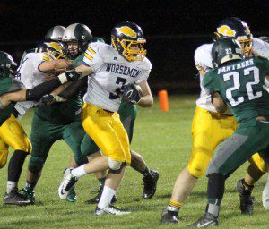 Norse runningback Andrew Butzow North find extra yards on the carry against Hesperia. Photo/Scott Stone