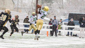 LaTommy Scott scores on the TD pass from Christian Martinez in the Crusaders semifinal win. Photo/Tim Reilly