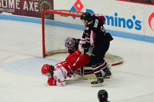 Dubuque's Carson VAnce end up on the wrong end of a play to the puck against Muskegon's Bo Hanson. Photo/Marc Hoeksema