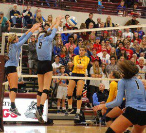 No. 1 Olivia Boeve gets a shot in for Grand Haven. Photo/Jason Goorman