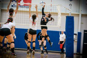MCC #6 Caroline Price with the spike on MPSH #11 Rachel Hauck and #15 Sophie Ruggles photo/Tim Reilly