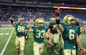 No. 88 Jacob Martinez, No. 33 Andrew Schulte and No. 6 Brody Kieft hold their hands up high after capturing the third-straight Division 8 state championship. Photo/Jason Goorman