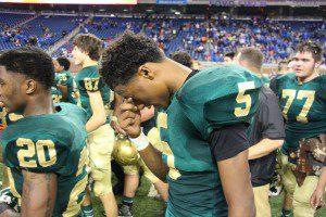 Muskegon Catholic quarterback Christian Martinez reacts after winning his team's third-straight state championship. Photo/Jason Goorman