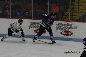 Max Humitz gets a stick on Tri-Cities Mattias Goransson. Photo/Carol Cooper