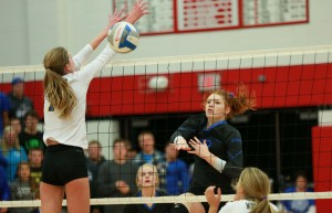 Emma Flagstead (12) spikes the ball to score a point against Grand Rapids NorthPointe Christian. Photo/Kevin Sielaff