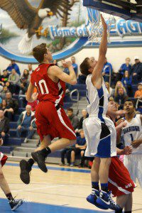 11 Nate Wahr gets by Whitehall's Franklin Uganski for the layup. Photo/Sherry Wahr