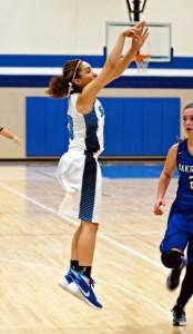 Alyza Winston shoots the 3-pointer for Mona Shores. Photo/Sherry Wahr
