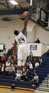 Mona Shores' Kobe Burse glides in for the dunk. Photo/Jason Goorman