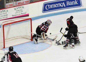 Lumberjacks' goalie Joey Daccord turns away a 3rd period scoring chance. (Photo/Eric Sturr)