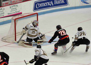 Lumberjacks goalie Joey Daccord kicks away a point blank shot. Photo/Eric Sturr
