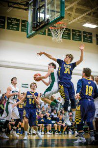 Riley Fairfield skies to stop WMC's No. 10 Nate Dugener from an easy bucket. Photo/Tim Reilly