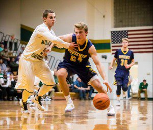 Erick Bleakley drives to the hoop against MCC's Walker Christofferson. Photo/Tim Reilly