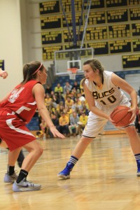 Grand Haven's No. 10 Andrea Shumaker is defended by Spring Lake's Sophie Conroy. Photo/Carol Cooper