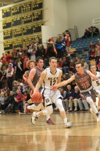 Lucas Steffel dribbles the ball up the floor with Spring Lake's Cameron Ball. Photo/Carol Cooper