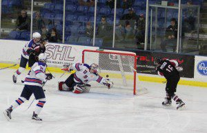 Rem Pitlick gets his shot past Team USA goalie Dylan St. Cyr giving Pitlick a goal in seven-straight Lumberjack games. Photo/Brian Tanis