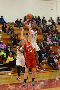 Muskegons Mardrekia Cook goes up for the shot against Kent Citys Kaitlyn Geers