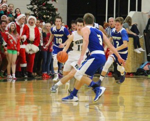Nate Dubener dribbles the ball up the court at NorthPointe's No. 3 TJ Swore. Photo/Jason Goorman