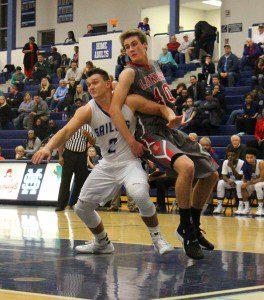 Mona Shores guard Tyler Trovinger battles Spring Lake's Sam Johnson under the basket. Photo/Jason Goorman
