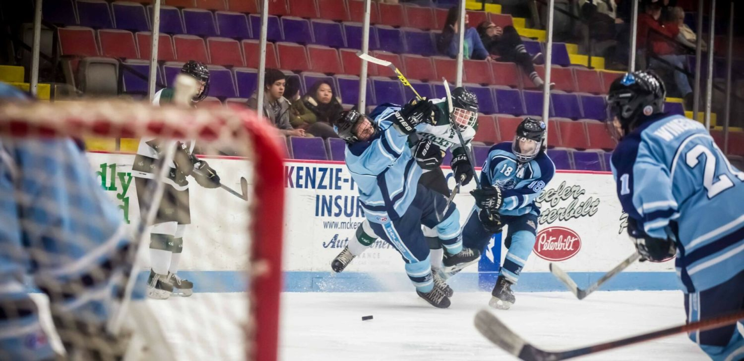 Mona Shores downs Reeths-Puffer 4-2 in a tight game between the cross-town hockey rivals