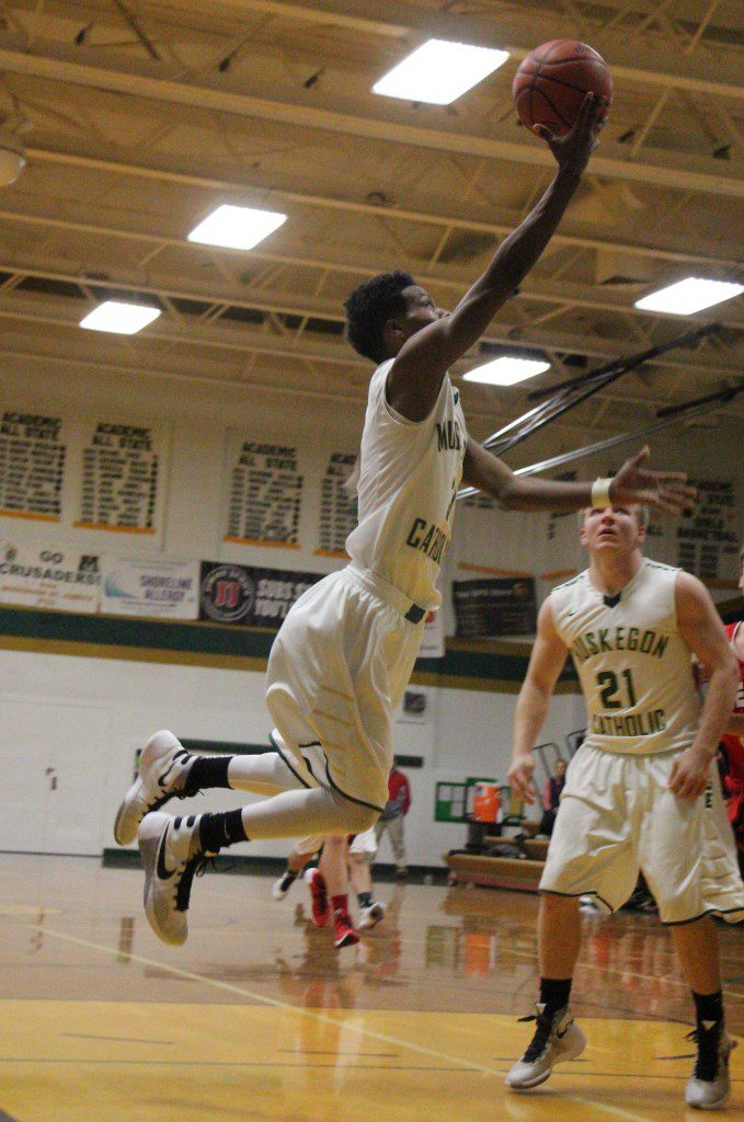 MCC's Christian Martinez glides in for two points. Photo/Jason Goorman