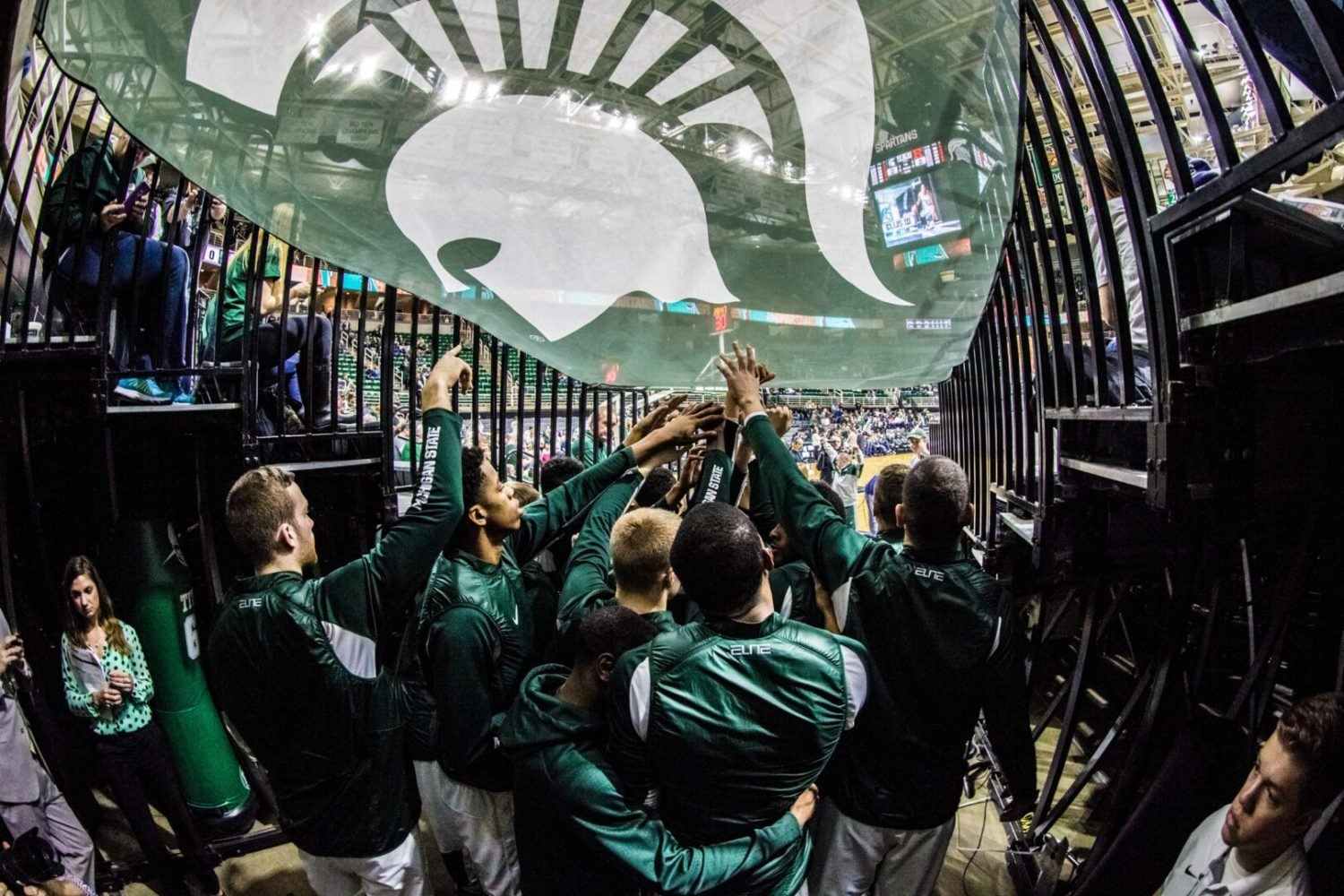 Check out a sneak peek of February's upcoming magazine with photos from the MSU win over Rutgers