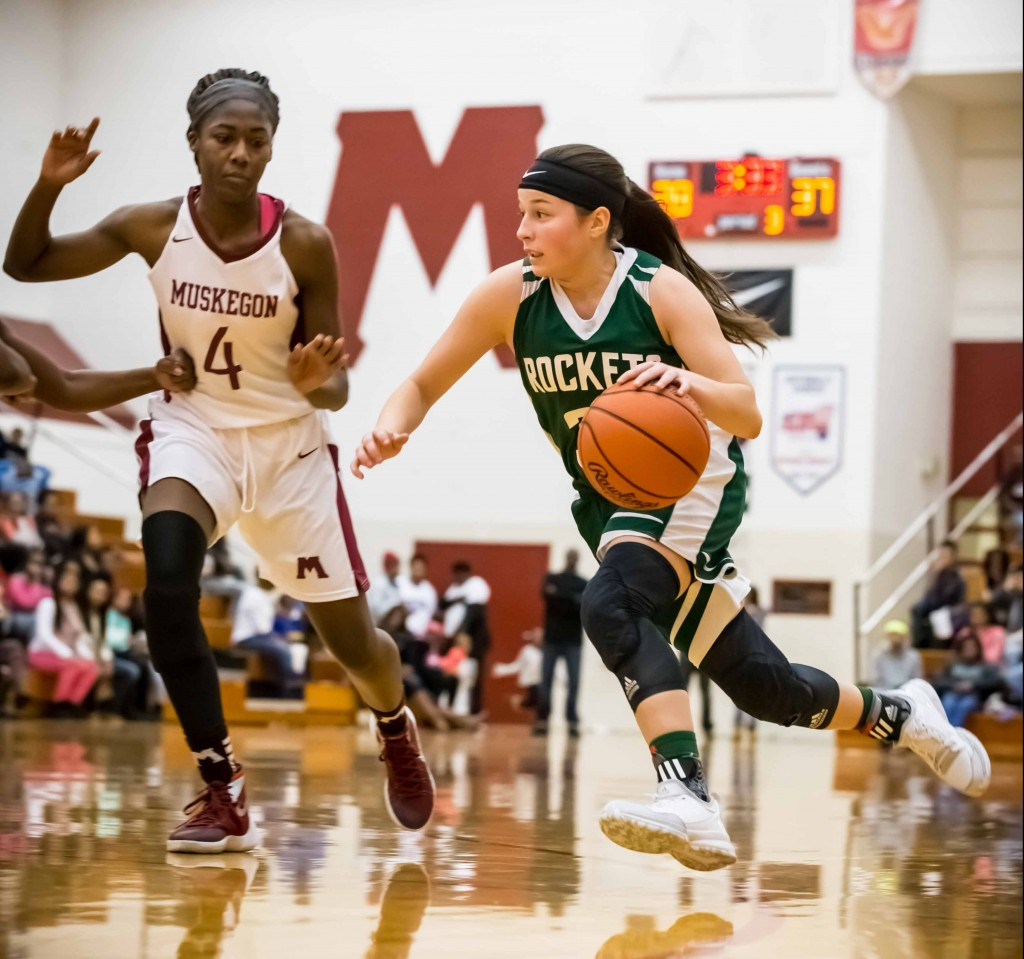 RP #32 Elysia Mattos drives against Muskegon #4 Rahmeen Hamilton photo/Tim Reilly