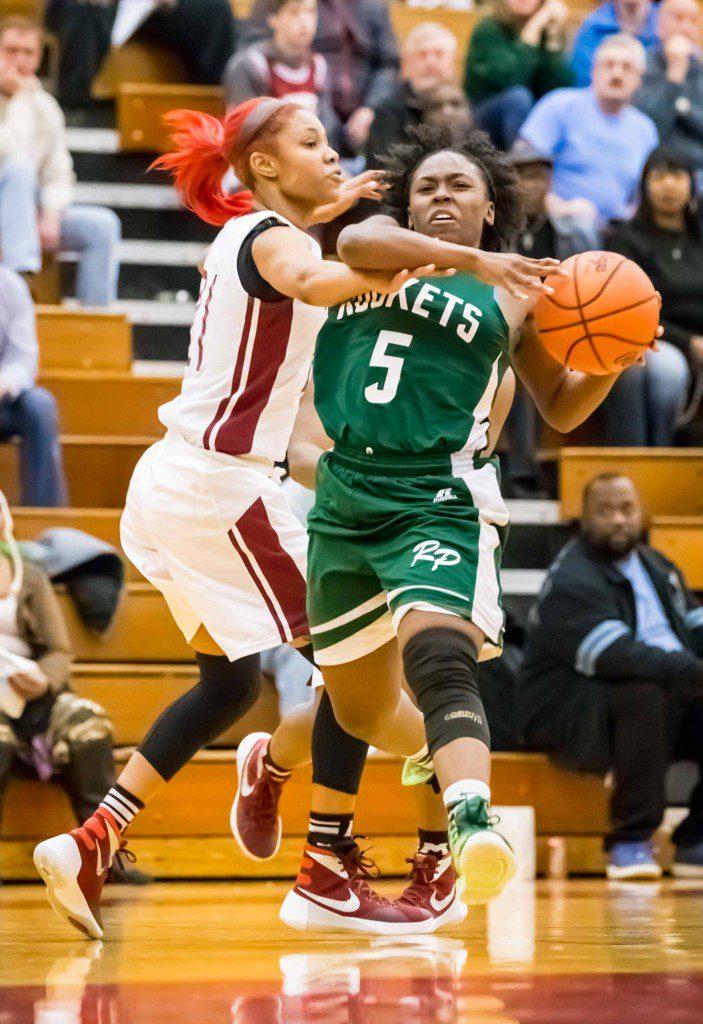 RP #5 Artrese Williams drives to the hoop as Muskegon #21 Tierra Williams defends photo/Tim Reilly