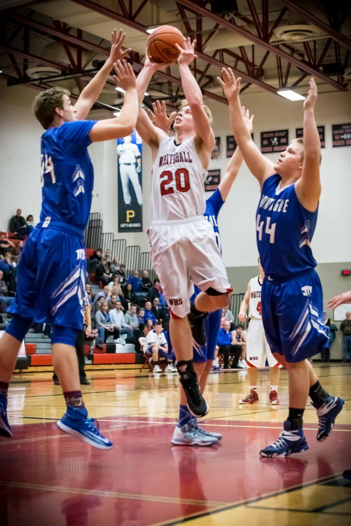 Whitehall #20 Keenan Aylor hits the jumper amongst a host of Montague defenders photo/Tim Reilly