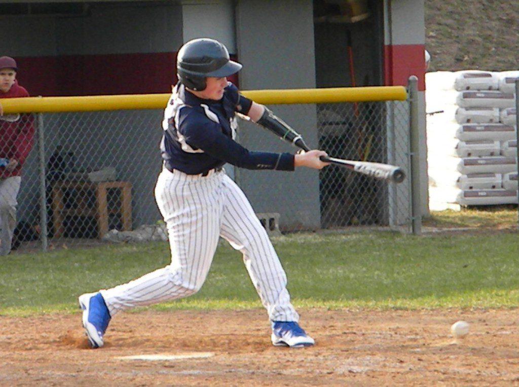 Karson Kriger takes a swing during a Fruitport JV baseball game last spring.