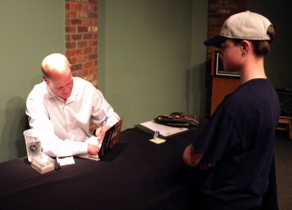 Kriger, then 13, gets Jim Abbott's autograph at a book signing by the former big league pitcher.