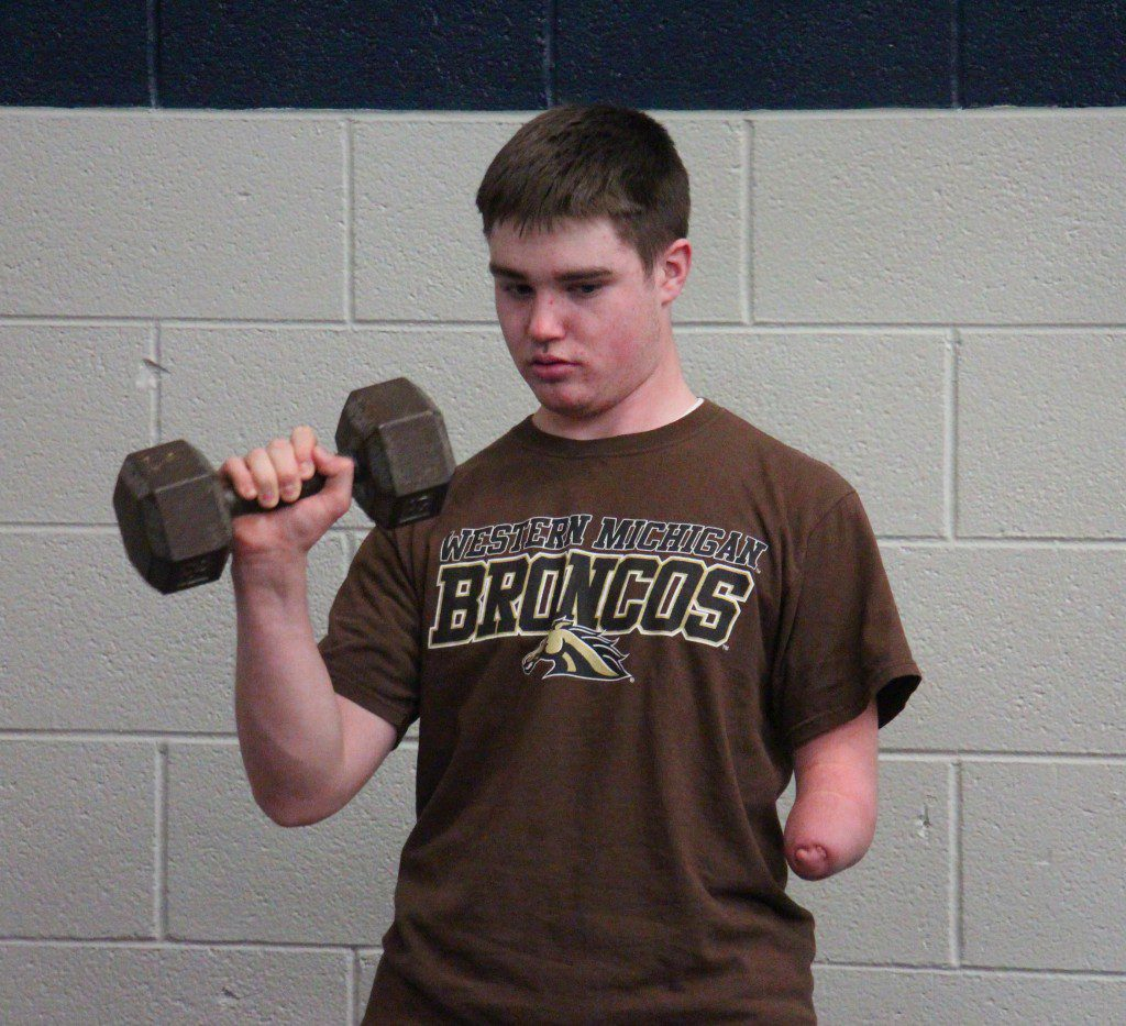 Preparing for baseball: Kriger strengthens his pitching arm during weight training.