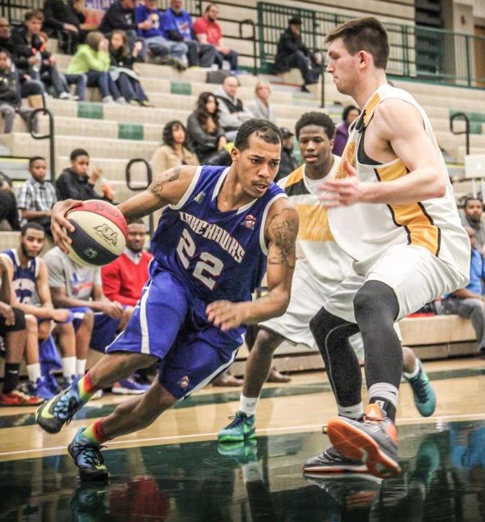 Tevin Bradley drives baseline for West Michigan. Photo/Joe Lane