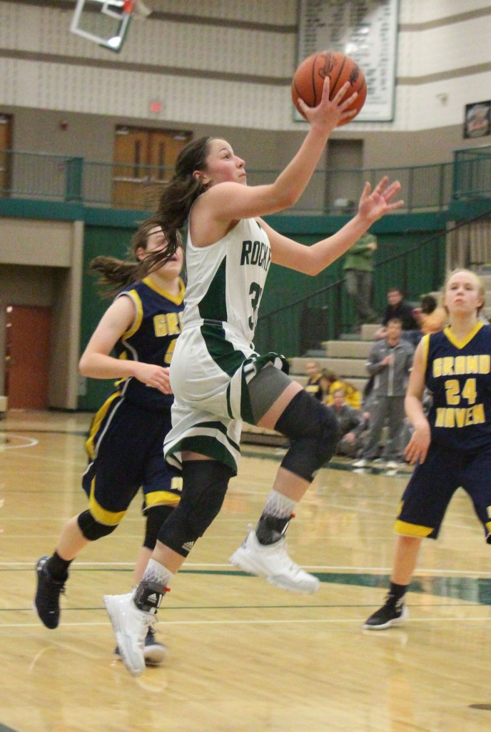 Elysia Mattos glides in for two points in Reeths-Puffer's win. Photo/Jason Goorman