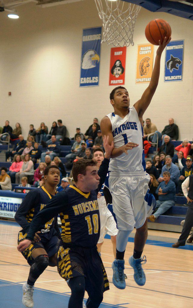 James Cooper III goes in for the Oakridge layup. Photo/Sherry Wahr.