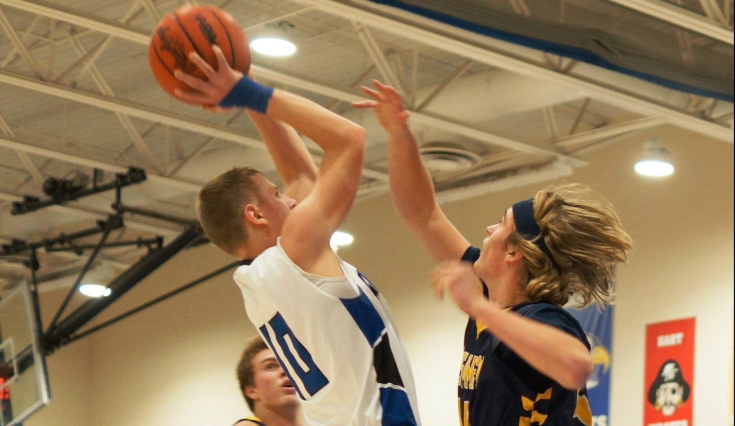 Oakridge boys hoops squad tightens up on 'D', heats up from 3 in win over North Muskegon