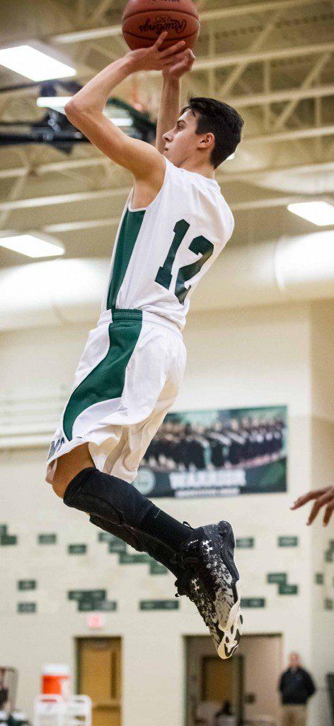 WMC guard Garrett Kraker goes up for the jump shot. Photo/Tim Reilly