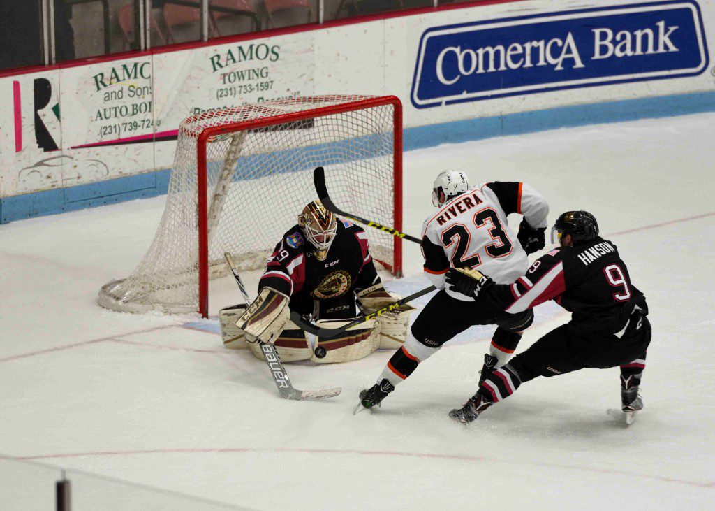 Lumberjack's goalie Joey Daccord (29) stops the point blank Lancers shot.  (Photo/Eric Sturr)