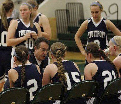 Fruitport Coach Bob German talks to his team during at timeout earlier this season.
