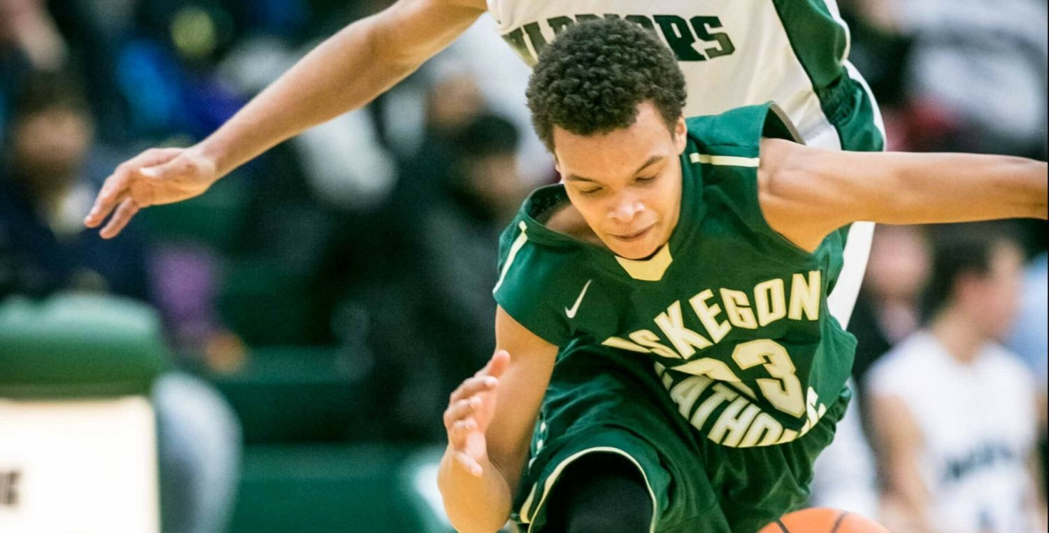 Muskegon Catholic boys hoops thrives in the clutch, bests rival WMC in OT